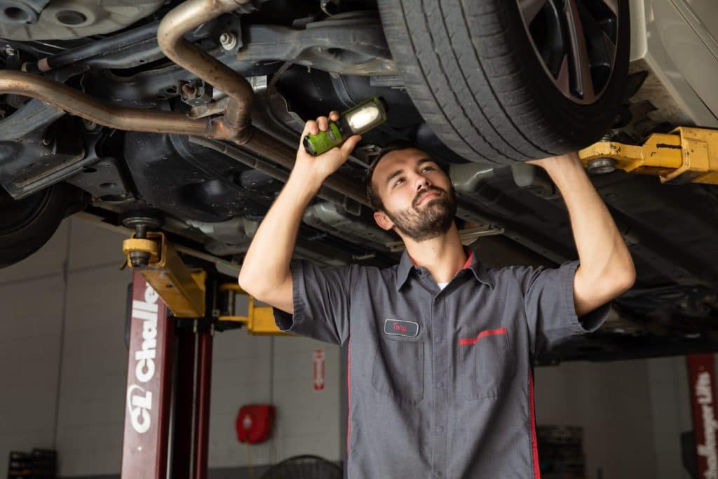 Service Man expecting Under Tires of Vehicle