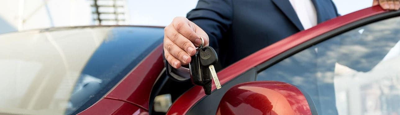 Returning car keys.