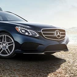 Shot of the front of a Mercedes Benz vehicle.
