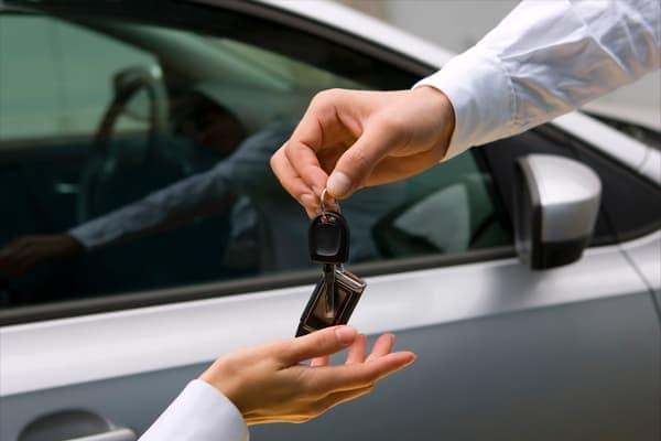 Two people exchanging keys