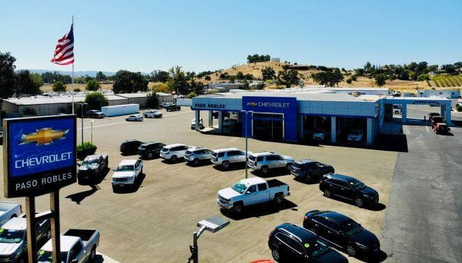 An exterior shot of a Chevrolet dealership during the day